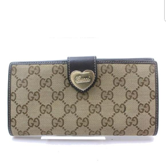 0b64f7875b4 Gucci Handbags - 100% Auth Gucci Canvas Leather Wallet